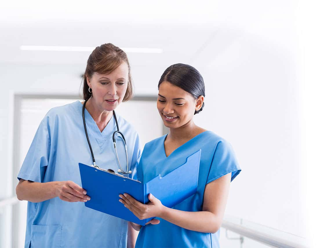 Nurses looking at blue folder